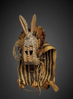 Africa | Mask from the dogon people of Bandiagara region, Mopti, Mali | ca. 1930s | Wood, pigment and natural fiber.