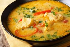 Brazilian fish Stew (Moqueca Baiana) with vegetables and coconut milk close-up on a plate on a table. Whole Food Diet, Whole Food Recipes, A Food, Keto Recipes, Paraguay Food, Endo Diet, Fertility Foods, Seafood Stew, Fish Stew
