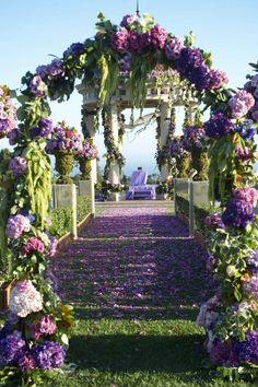 Purple flower arch at ceremony