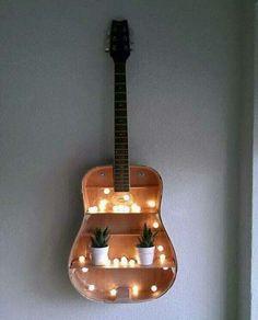 Creatief met kapotte gitaar