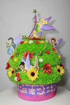 I made this cupcake pinata for a friend the fairy's are made of wood to great wall hanging's.