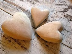 Wooden hearts as place settings or have guests names added to the opposite side as paper weight gifts placed at the center of a charger plate.