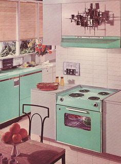 We had a Fridgidaire and stove top in this color......A cheerfully aqua hued GE kitchen from 1963.
