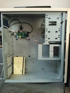 """Raspberry Pi PC - I don't feel so bad anymore.  I have a stack of old PC's and cases and have pondered stuffing microcontrollers in them.  The only problem is that since they look like regular PC's the """"wow"""" factor is lost no matter how many RPi's and Arduinos you stuff inside."""