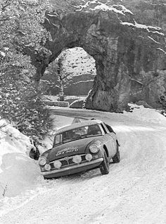 Old Faithful GRX307D stuck in snow on the 1966 Rally Monte Carlo. Co-driver Ron Crellin gives Tony Fall a push.