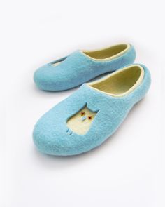 Felted adult size wool slippers by Simonascrafts on etsy.  WANT.