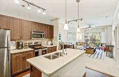 Live in luxury with chef-inspired gourmet #kitchens boasting stainless steel appliances, quartz counter tops, and spacious kitchen islands. #Georgia #Apartments