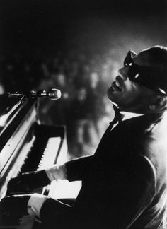 Ray Charles. I remember this first time I heard him sing. I was a little girl at my grandmas house and she told me he was blind.
