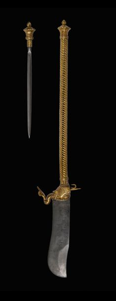 19th century Indian bhuj. Haft contains screw-in dagger blade.