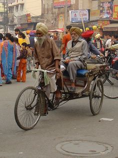 Rickshaw. A public transportation vehicle, pulled by a human. India.