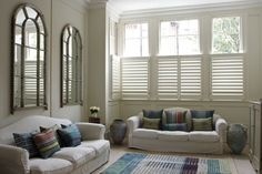 The Cafe style shutters, (covering just the lower half of the window), offer a degree of privacy in the living room, whilst allowing the light to flood in.