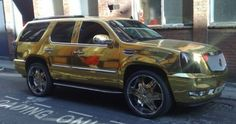 Blackburn Rovers' striker El Hadji Diouf unveiled his latest motor yesterday, a shiny gold Cadillac Escalade which he parked in a loading bay in Manchester Luxury Blog, Luxury Suv, Flight Of The Navigator, Chrome Cars, Cadillac Escalade, Automobile, Plating, Vehicles, Sophisticated Style