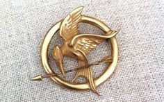The Mockingjay Pin Katniss Wore In 'The Hunger Games' Had A Stunt Double Hunger Games Mockingjay Pin, The Hunger Games, Hunger Games Movies, Hunger Games Trilogy, Katniss Everdeen, Tribute Von Panem, Mocking Jay, Catching Fire, Etsy Jewelry