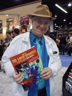 John Sebastian checks out the new The Lovin' Spoonful songbook at the Hal Leonard NAMM booth.