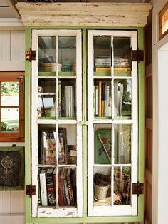 A pair of eight-pane windows that serve as doors, the books are arranged on three deep shelves. A piece of crown molding finishes the bookcase in style. Painted Furniture, Diy Furniture, Furniture Design, Shed Organization, Organizing, Old Windows, Antique Windows, Vintage Windows, Recycled Windows