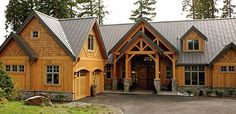 I like the two-tiered entry & the details over the cedar shingles.
