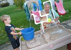sand/water table turned into endless water fun with pvc pipes #happyfamilysummer