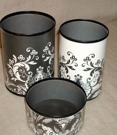 This decorative can set is made from recycled aluminum cans which are covered with decorator paper and clear contact paper.