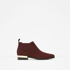 Image 1 of FLAT LEATHER ANKLE BOOTS WITH METAL PLAQUE from Zara
