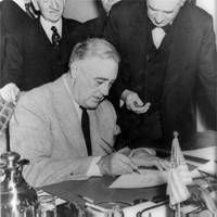 President Roosevelt signs the Declaration of War against Japan, December 1941
