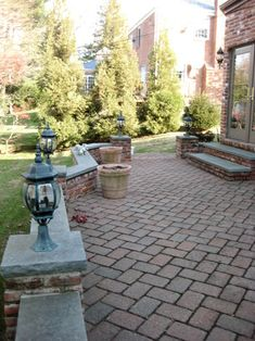 paver patio with stone walls & lights....love!!!