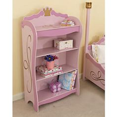 KidKraft Princess Bookcase: What a charming way to encourage early reading (not to mention neat bedrooms!). KidKraft's pink and gold princess-themed bookshelf has four deep shelves for storing books, games, and toys, all within her reach. Its crowning glory: a secret compartment under the hinged top shelf for holding hidden treasures...
