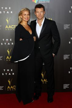 Lara Bingle iN Ellery and Sam Worthington in Louis Vuitton at the AACTA Awards in 2014