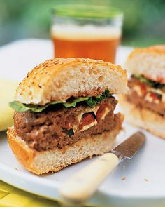 The toppings go on the inside in these fun burgers! Sandwich fresh mozzarella, halved grape tomatoes, and herbs between beef patties -- Stuffed Beef Burgers Recipe