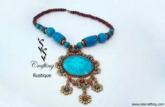 www.isiscrafting.com An epitome of ethnicity fused with #style, this #necklace would strike a statement that #speaks #volumes about the #woman wearing it. The #heart of the necklace is #beautifully seized in this huge blue stone. Adding to the drama, the flower-shaped drops in antique gold, with red and blue stones accentuating the #beauty, garner instant attention. with #IsisCrafting