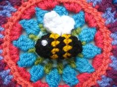 Bumble bee ///scraps of black, white and golden yellow DK weight yarn with a 3mm hook, and the little fella has come out pretty much life-size, measuring just 3cm long.