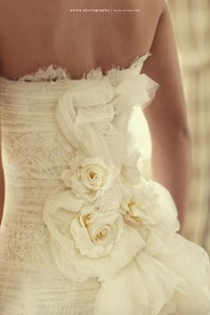 Love the Lace and Flower Detailing  http://media-cache9.pinterest.com/upload/125467539588875908_HSfnF13S_f.jpg sarahbeth727 any girl can dream right wedding