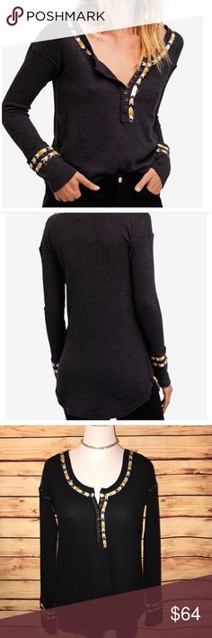 Free People We The Free Black Rainbow Thermal Awesome soft and stretchy black thermal henley style top embroidered with patterned braids of textured color. Crew neckline with button front closure. BNWT, no flaws. Excellent quality and condition. Check out my other listings to bundle and save! Free People Tops Tees - Long Sleeve