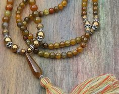 Beautiful faceted agate mala necklace by look4treasures on Etsy