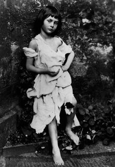 Alice Pleasance Liddell in a photograph taken by Lewis Carroll. Alice Liddell was Carroll's inspiration for Alice's Adventures in Wonderland. There is reason to suspect that Carroll had inappropriate feelings for Alice, although it has never been proven.