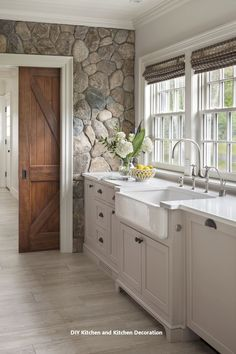 Interior Design Kitchen Farmhouse sink with white painted cabinetry set against cobbled stone wall. Design by Patrick Ahearn Architect - See why we're dying over this natural trend! Sweet Home, Cuisines Design, Design Case, Wall Design, Door Design, Cabinet Design, Kitchen Interior, Design Kitchen, Interior Stone Walls