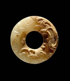 China, Two-Sided Bi Disc-Ring with Incisded Scroll Pattern and Relief Dragon, Han Dynasty, 206 BCE - 220 CE. Jade