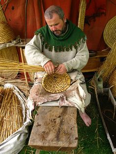 15th century basket weaver (Appears to be making bee skeps in a manner that would still be appropriate in the 16th century)