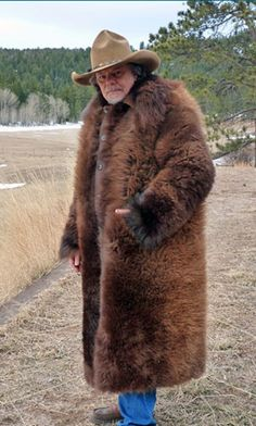 Michael Guli Designs buffalo clothing is made from the finest buffalo hide. The longest, thickest fur is used around the collar to provide maximum warmth. Bear Fur Coat, American Bison, Native American, High Fashion, Mens Fashion, Mens Gear, Michael J, Mountain Man, Buffalo