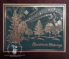 This is done with silver heat embossing. The stamps are from the sets Lovely as a Tree, Star of Light and Christmas Pines for the Sentiment. The card stock is I