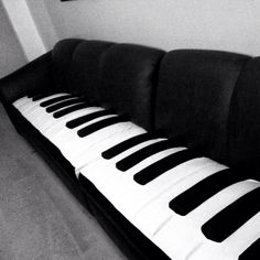 Now that is a couch. The best place to relax would be on those piano keys #decor #sofa