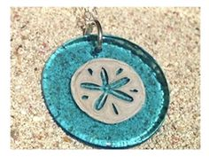 We love this aqua glass and silver pendant!  The image is hand painted onto the colorful glass using silver!  Comes with silver chain.  Proudly made in Rockport, Massachusetts!