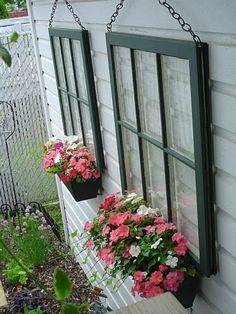 This would be great for my large back wall that has a lot of stucco and no windows. DIY: Take a discarded window, repaint and attach a chain hanger. Place on the side of a garage or shed with no windows. Put a planter box with flowers underneath....beautiful and easy to do!!