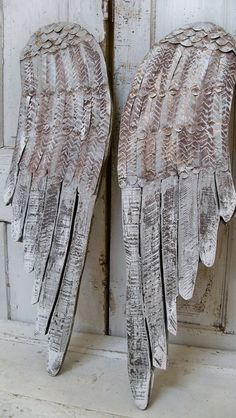Large gray wings wooden wall sculpture distressed hand carved metal home decor Anita Spero. These are layers of white over soft gray. Under those colors you will find hints of gold and bronze. I distressed then a lot. Giving the look of beach erosion.      The weathered wings can be hung in any position on your wall, or propped against the wall on your floor, furniture or can be added to your French inspired vignette. Lovely as a holiday decor piece but absolutely can be left up all year…