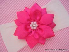 Faixa em meia de seda com flor de cetim.  A flor mede aproximadamente 8 cm.    IMPORTANTE!!!  LEIA AS POLÍTICAS DA LOJA ANTES DE ENVIAR SEU PEDIDO. R$ 9,90