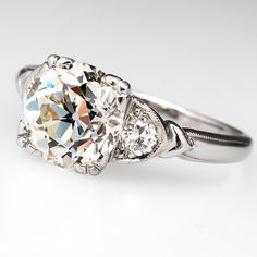 Antique engagement rings from the Art Deco period were commonly crafted of platinum and featured old european cut diamond center stones and old euro or single cut accent diamonds.