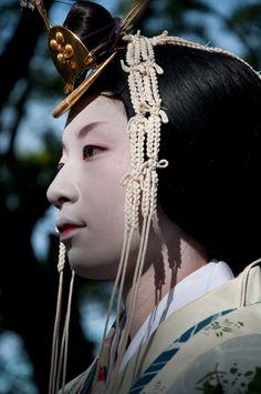 A woman dressed as an uneme in Aoi Matsuri.