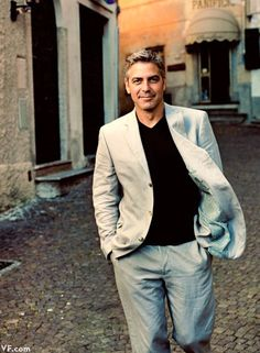 """George Clooney, who owns one of the Lake Como's prized Italian villas, takes a stroll through Argegno. Photographed by Annie Leibovitz for Vanity Fair's article, """"Crazy for Como,"""" September 2007 issue (photo originally published October Famous Photos, Famous Faces, Vanity Fair, Fashion Mode, Mens Fashion, Fashion Trends, Gorgeous Men, Beautiful People, Celebridades Fashion"""