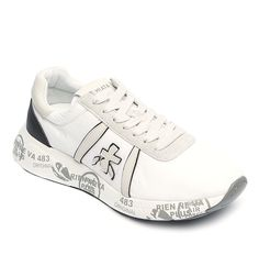White tone suede and waterproof fabric sneaker with sculptured sole from Premiata Sneaker. A round classic sneaker toe, cotton lace up closure. Mix calfskin in off-white and black tones mixed waterproof fabric. Contrast and printed texture rubber sole in white tone. Leather insole. Dual-density rubber out sole. Logo print at front. Patented model.  Item Code: 1498  Materials: leather, rubber, fabric  Made in Italy