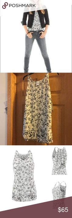 Terrace Cami (spring '17) Nonsmoking home. Excellent condition. Never worn/sample only. A moody floral print that covers you with flowy layers of chiffon, the Terrace Cami features a graphic ombre effect and skims the body in a flattering A-line shape.  Grayscale floral print Halter-style cami with multiple layers for coverage Delicate ruffle details A-Line shape Polyester chiffon  Fabric: Self: 100% Polyester Lining: 100% Polyester CAbi Tops