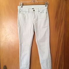 Skinny jeans with light light blue stripes Good condition skinny jeans! GAP Pants